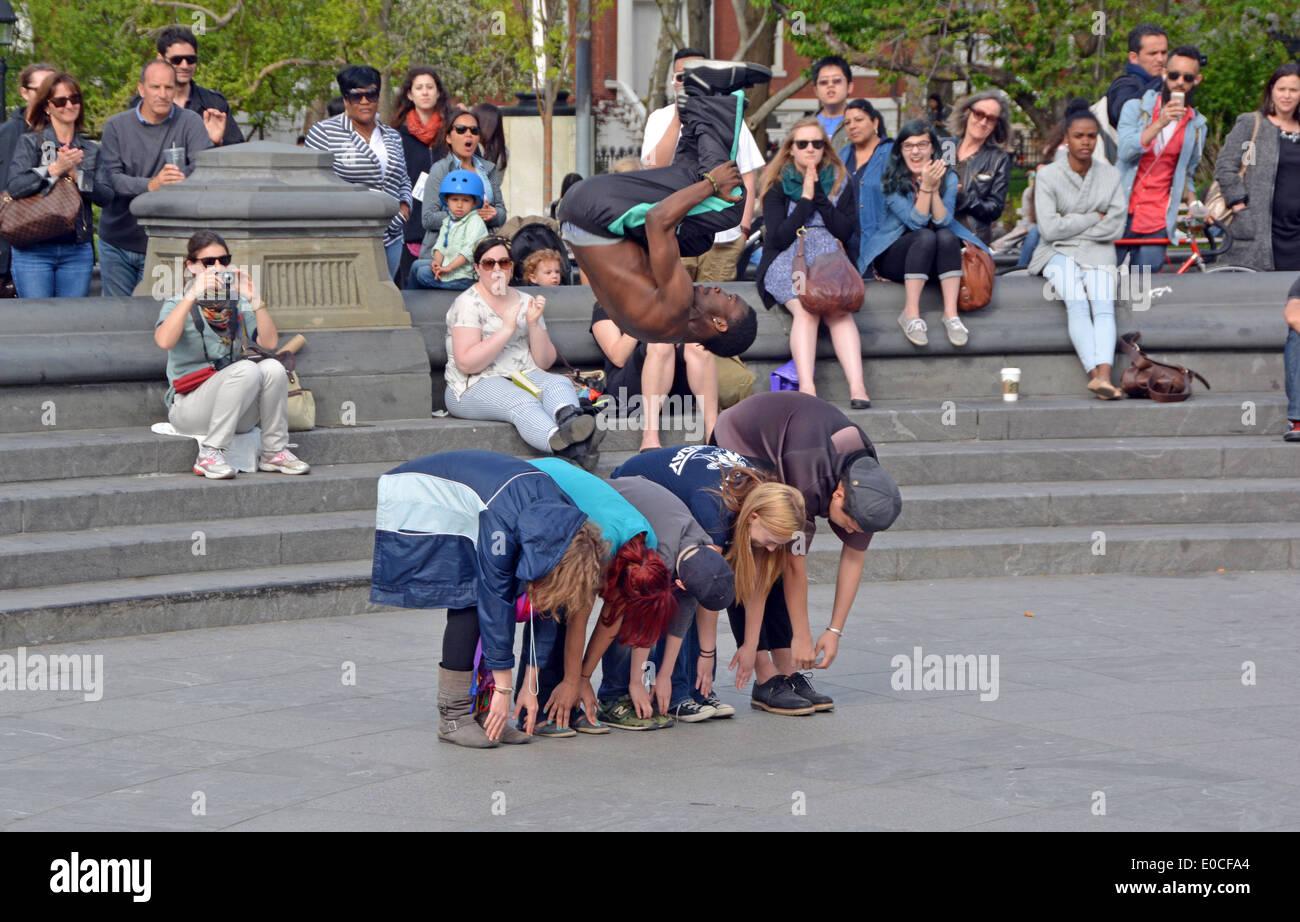 An acrobat dancer, stunt performer in Washington Square Park in Greenwich Village, New York City Stock Photo
