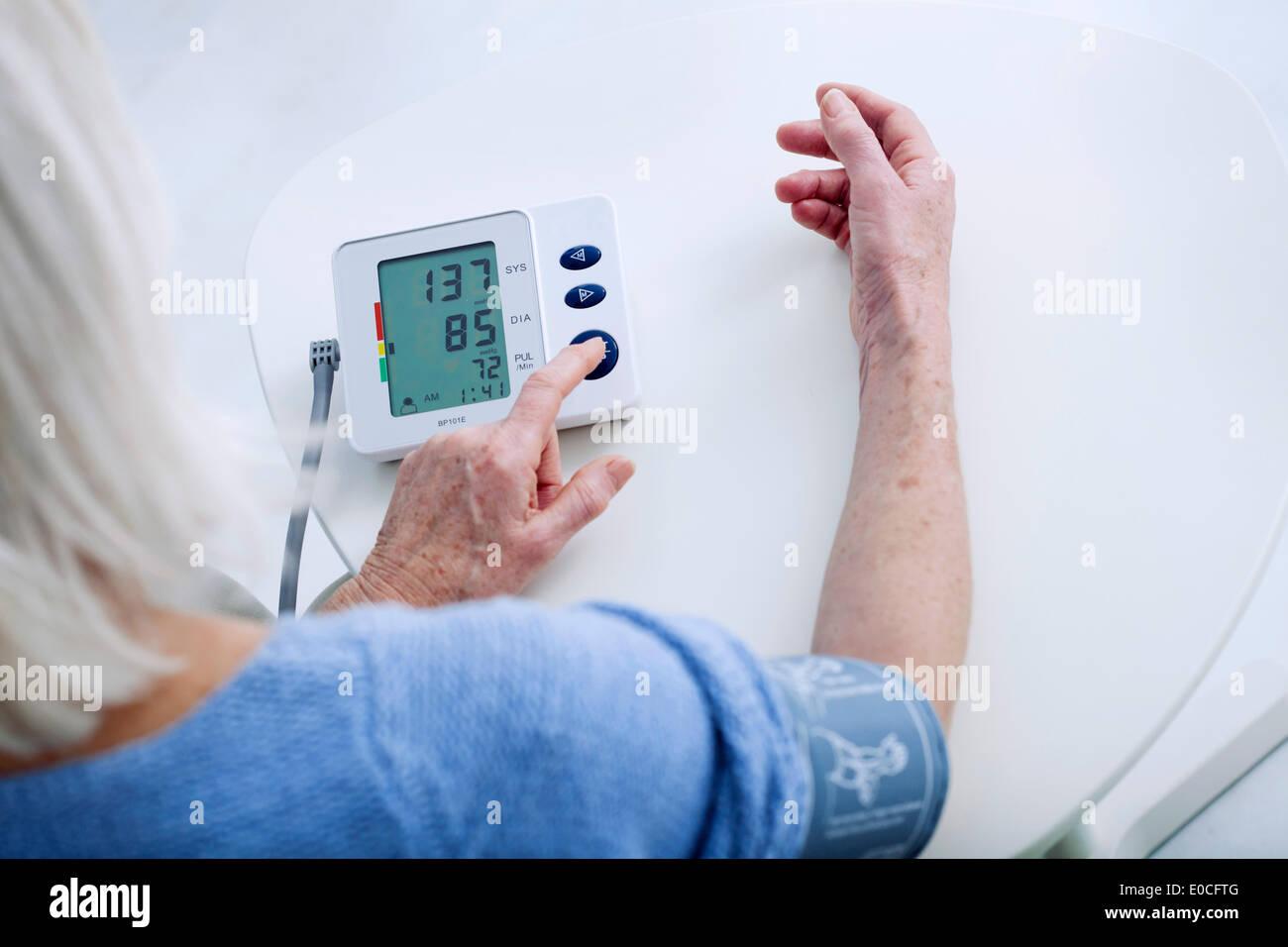 Blood pressure, elderly person - Stock Image