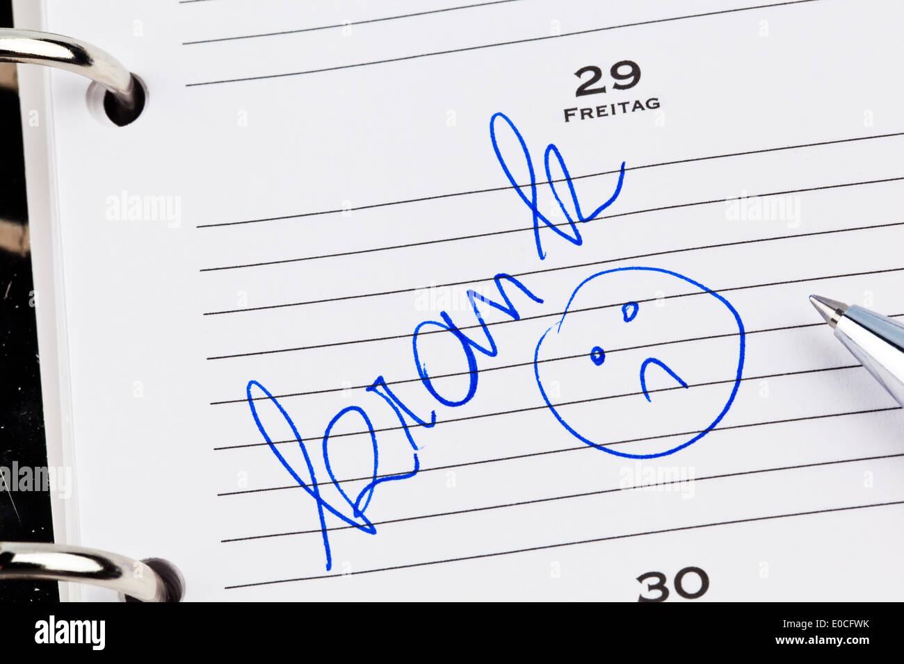 An appointment is put down in a calendar: Ill, Ein Termin ist in einem Kalender eingetragen: Krank Stock Photo