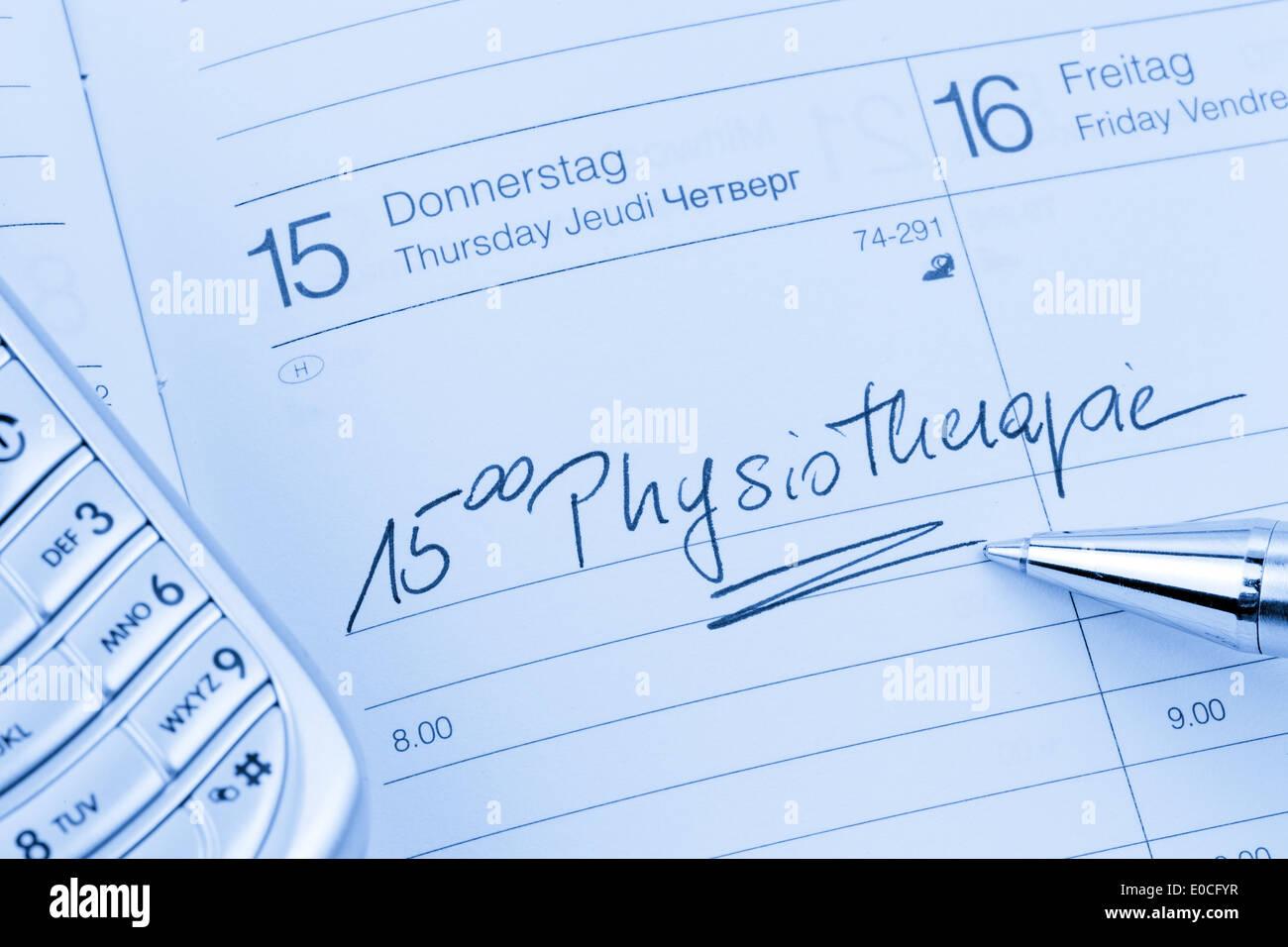 An appointment is put down in a calendar: Physiotherapy, Ein Termin ist in einem Kalender eingetragen: Physiotherapie Stock Photo