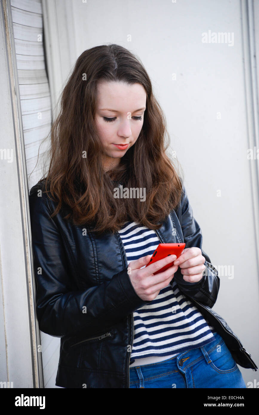 Adolescent with phone - Stock Image