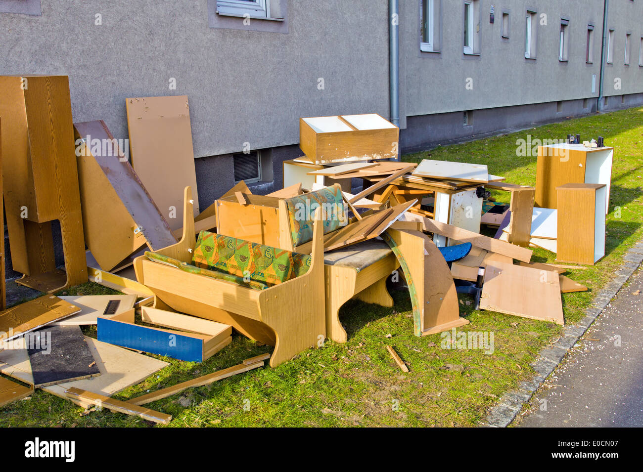 Old pieces of furniture wait for the Sperrmuell collection of the local authority Stock Photo