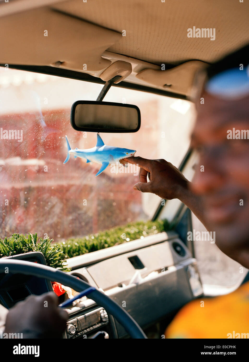 Fisherman with plastic shark in his car, at the fish market, Mindelo, Sao Vicente, Ilhas de Barlavento, Republic Stock Photo