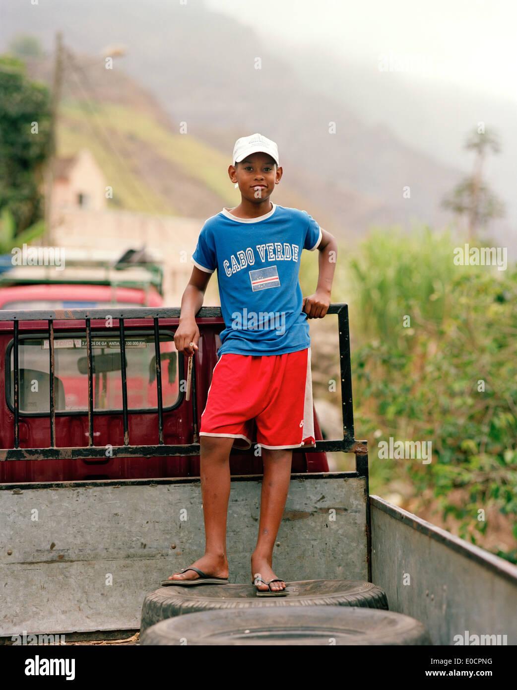 Boy on the bed of a pickup at the village Cha Manuel Dos Santos, Valle Paul, Santo Antao, Ilhas de Barlavento, Republic Stock Photo