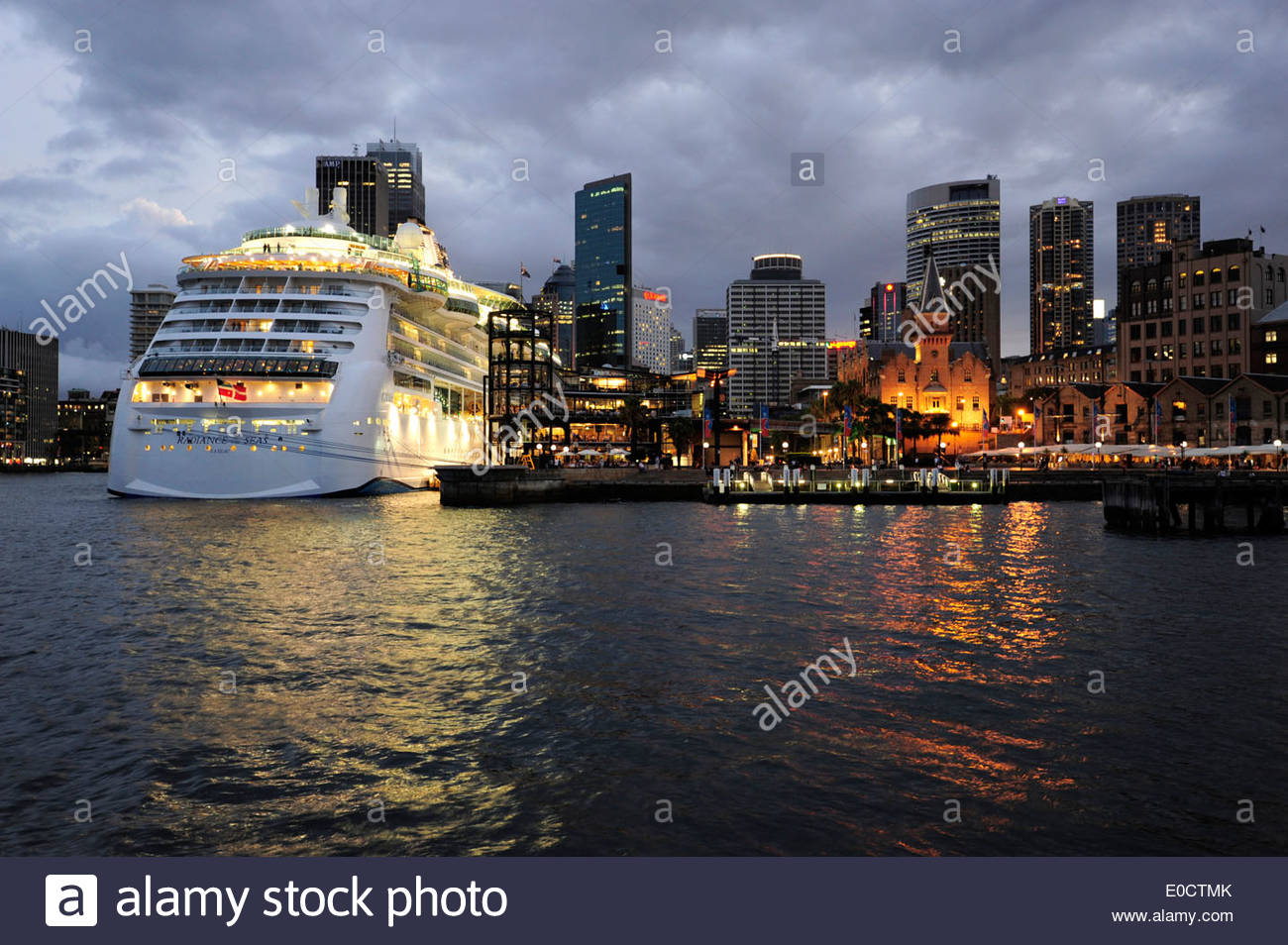 Skyline of the Central Business District and cruise ship at the Overseas Passenger Terminal in the evening, The Rocks, Sydney Ha - Stock Image