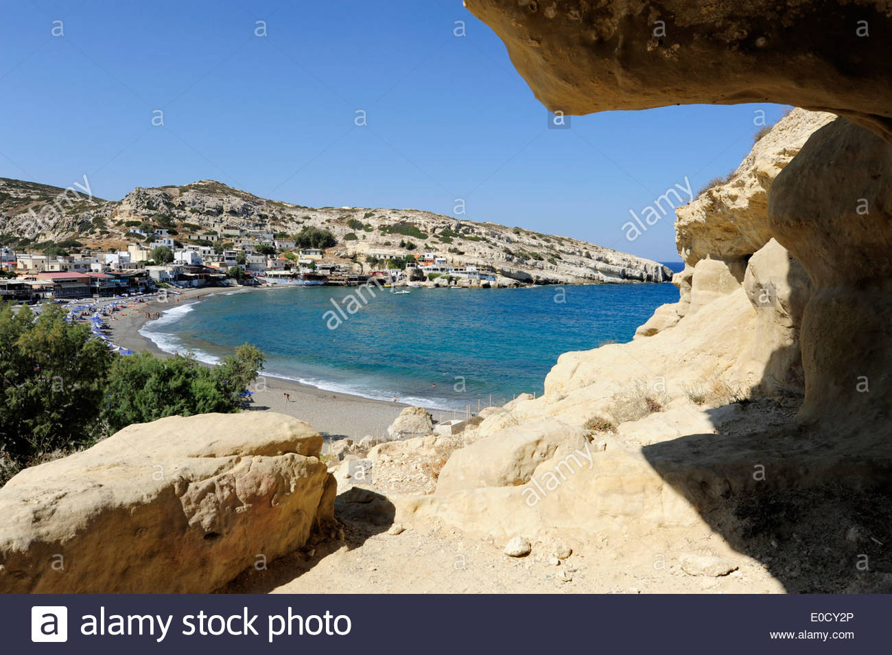 Prehistorical cave with view of the beach of Matala, a village on the south coast of the greek island Crete, Mediterranean Sea, - Stock Image