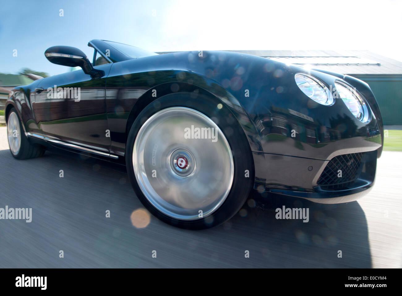 pole mount rig action shot of 2013 Bentley GTC luxury British convertible car - Stock Image