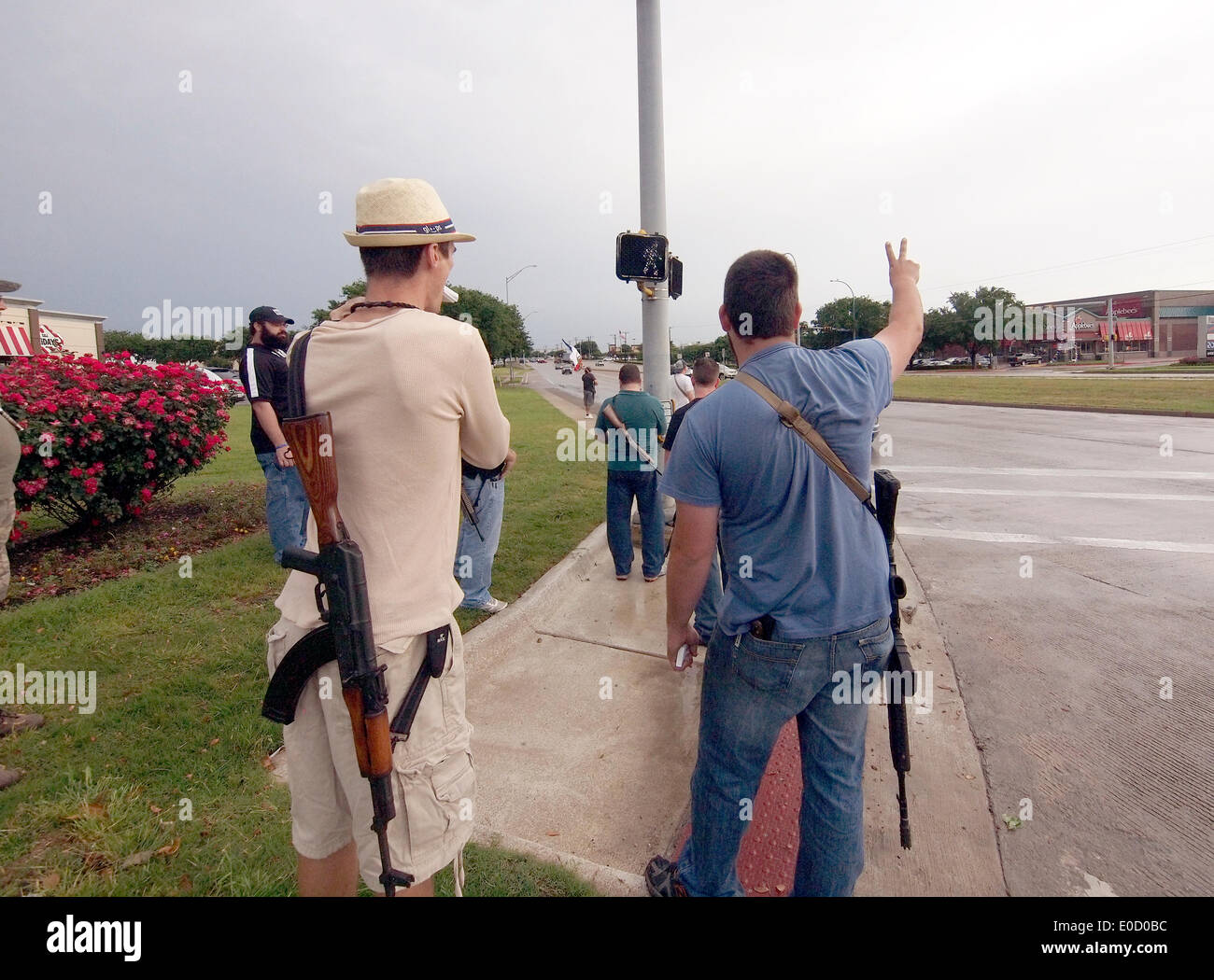 Group of gun owners see laws preventing them from carrying weapons as aright. Protest in 1016 along the streets of Arlington, Texas, they want people to see the guns, carry big rifles on the street and try to enter local fast-food stores in the area. When they enter all the employees run to the back and hide. Formed by guns-rights activist Kory Watkins. - Stock Image