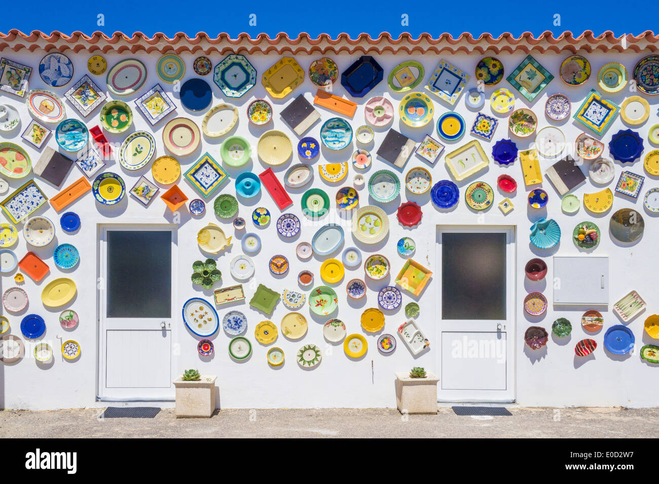 Portuguese Traditional Pottery souvenir shop with plates decorating the outside walls Sagres Algarve Portugal EU Europe - Stock Image