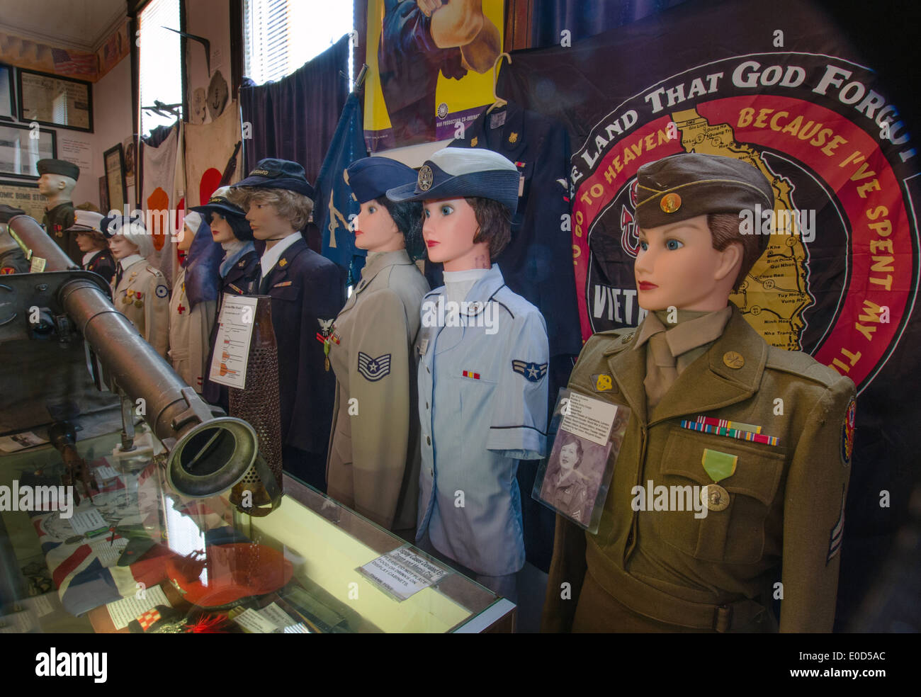 An exhibit of military servicewomen in the Route 66 Hall of Fame and Museum in Pontiac, Illinois - Stock Image