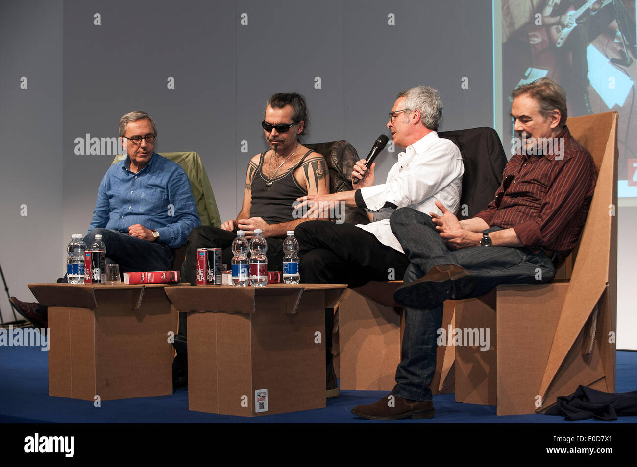 Turin, Piedmont, Italy. 09th May, 2014. Lingotto Fair 27th International Book Fair  9th May 2014.the Italian way, to rock between the stage and the talent Piero Pelù. The Dictionary of Rock Zanichelli rewards Piero Pelù, rock star and judge of the television program, The Voice( italy ). intervened, Enzo Gentile, Mauro Pagani and Alberto Tonti Credit:  Realy Easy Star/Alamy Live News - Stock Image