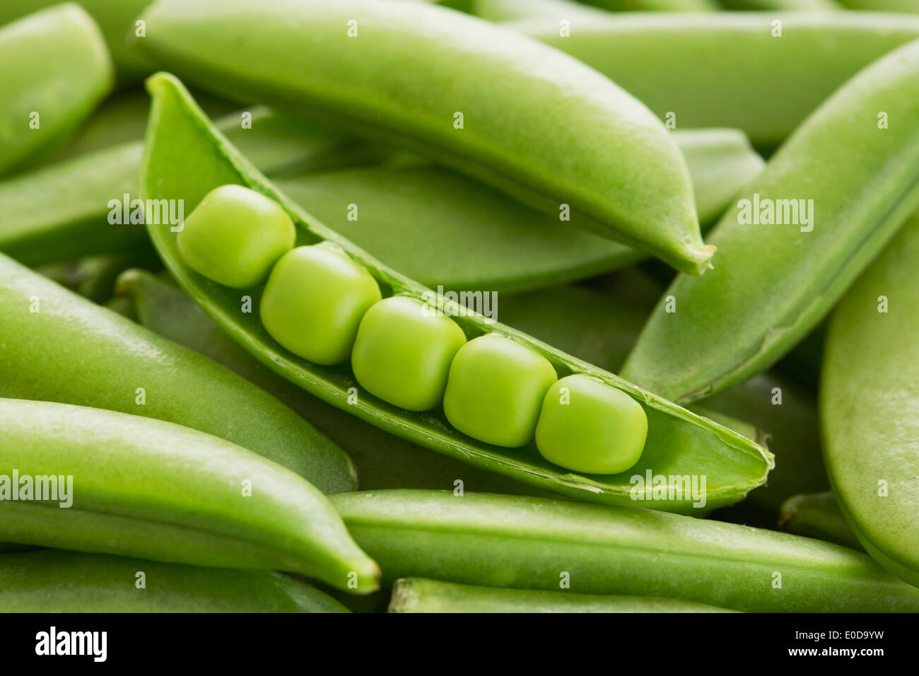 Close-up of peas in pea pod - Stock Image