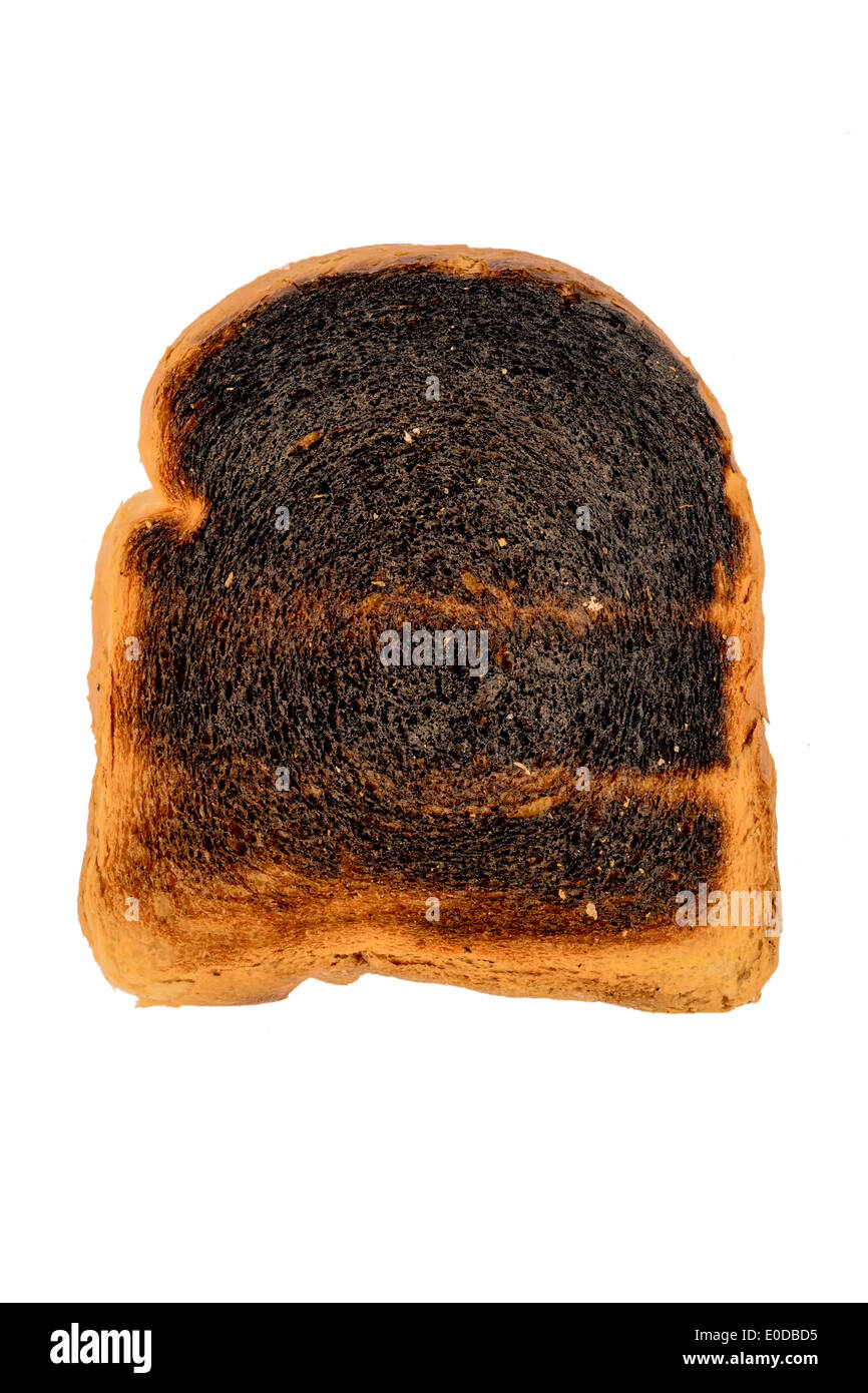 Toast bread became burntly. Burntly toast discs with the breakfast., Toastbrot wurde beim toasten verbrannt. Stock Photo