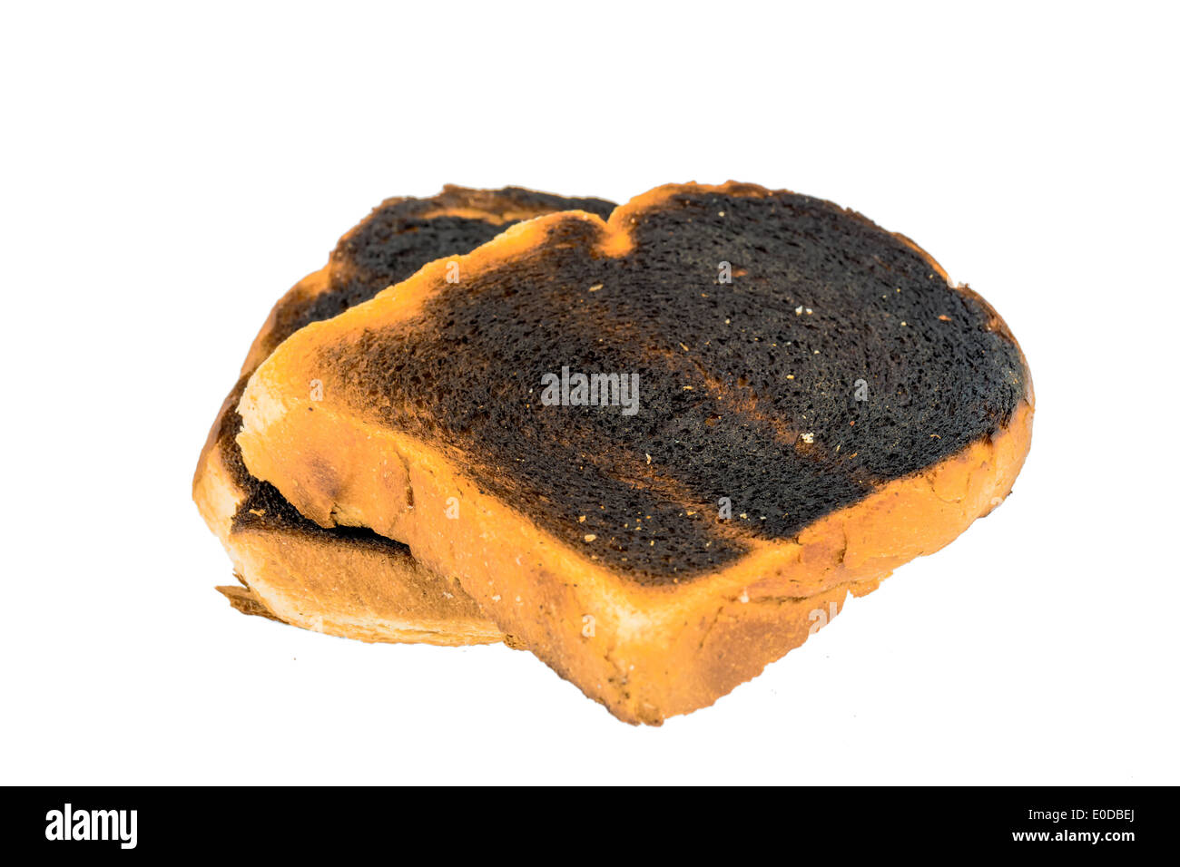 Toast bread became burntly. Burntly toast discs with the breakfast., Toastbrot wurde beim toasten verbrannt. - Stock Image