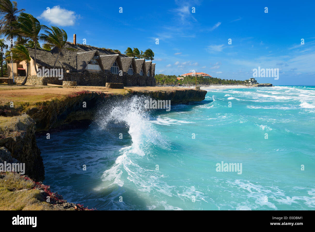 Wave rebounding off lava rock shore causing splash in high wind at Varadero Cuba beach resort - Stock Image