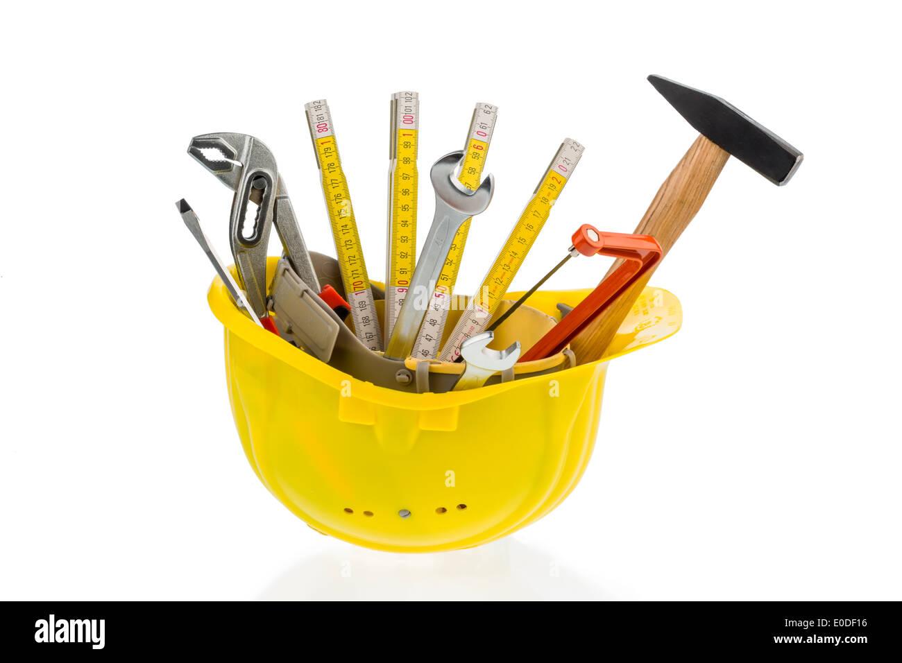 Different tools of a craftsman lie side by side on white background, Verschiedene Werkzeuge eines Handwerkers liegen Stock Photo