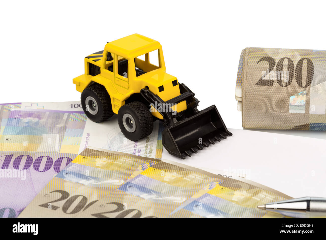 A bill of sale for new excavator. Invest in new vehicles brings cost advantages. With Swiss Franconia, Ein Kaufvertrag fuer neue - Stock Image