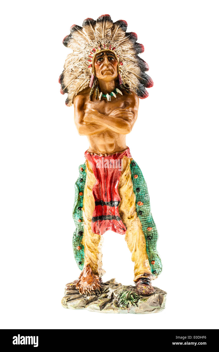 a small indian chief figurine isolated over a white background - Stock Image