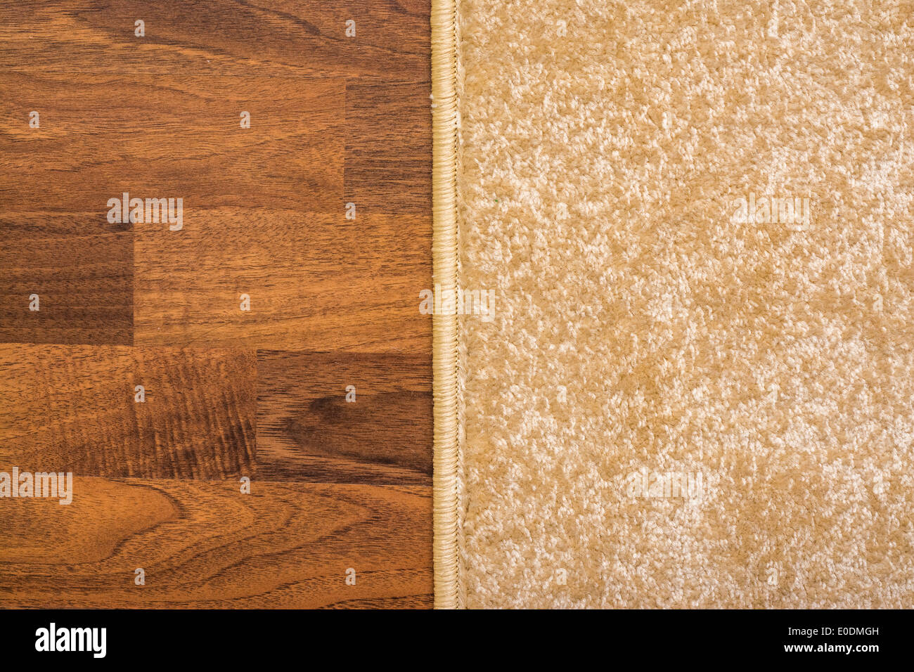 Living Room Carpet On Wood Parquet Close Up - Stock Image