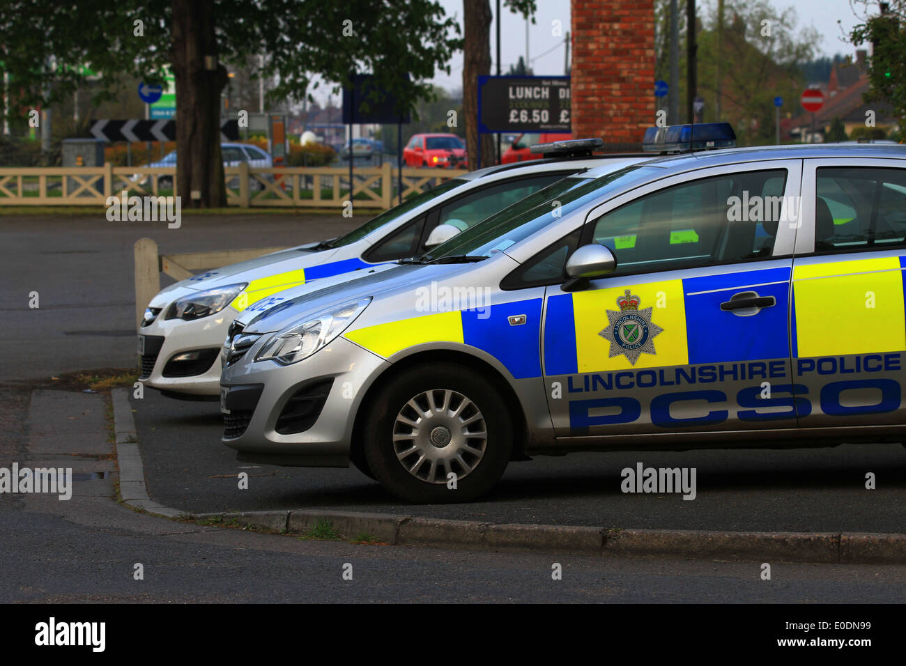 Police cars Ford Vs Vauxhall who will win  Fight, Harry Hill style. Fords are dated and Vauxhall don't use very strong glue. - Stock Image