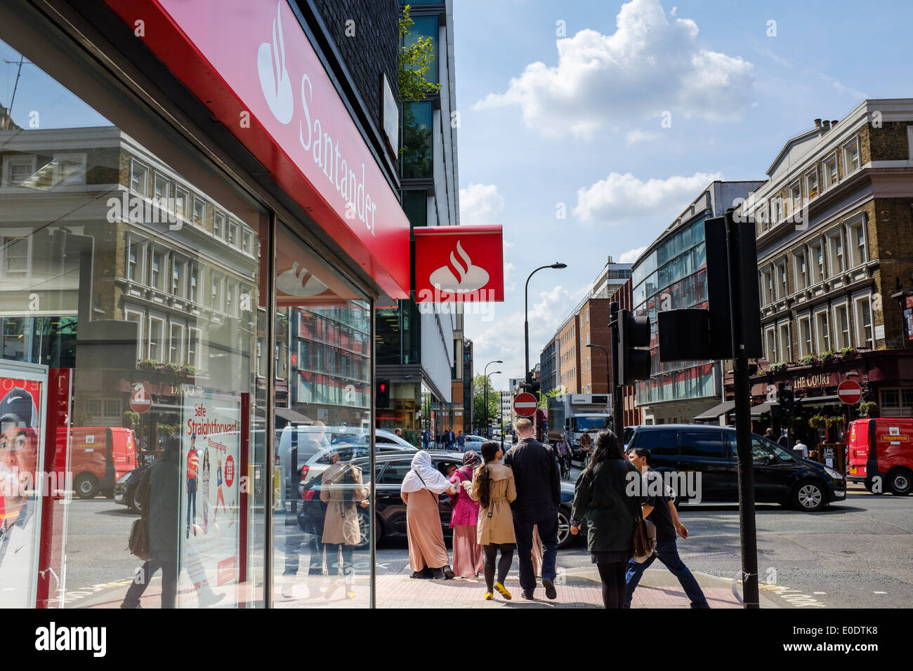 A high street branch of the Santander Bank on Tottenham Court Road, London, England, UK, Britain, British on a sunny day. - Stock Image