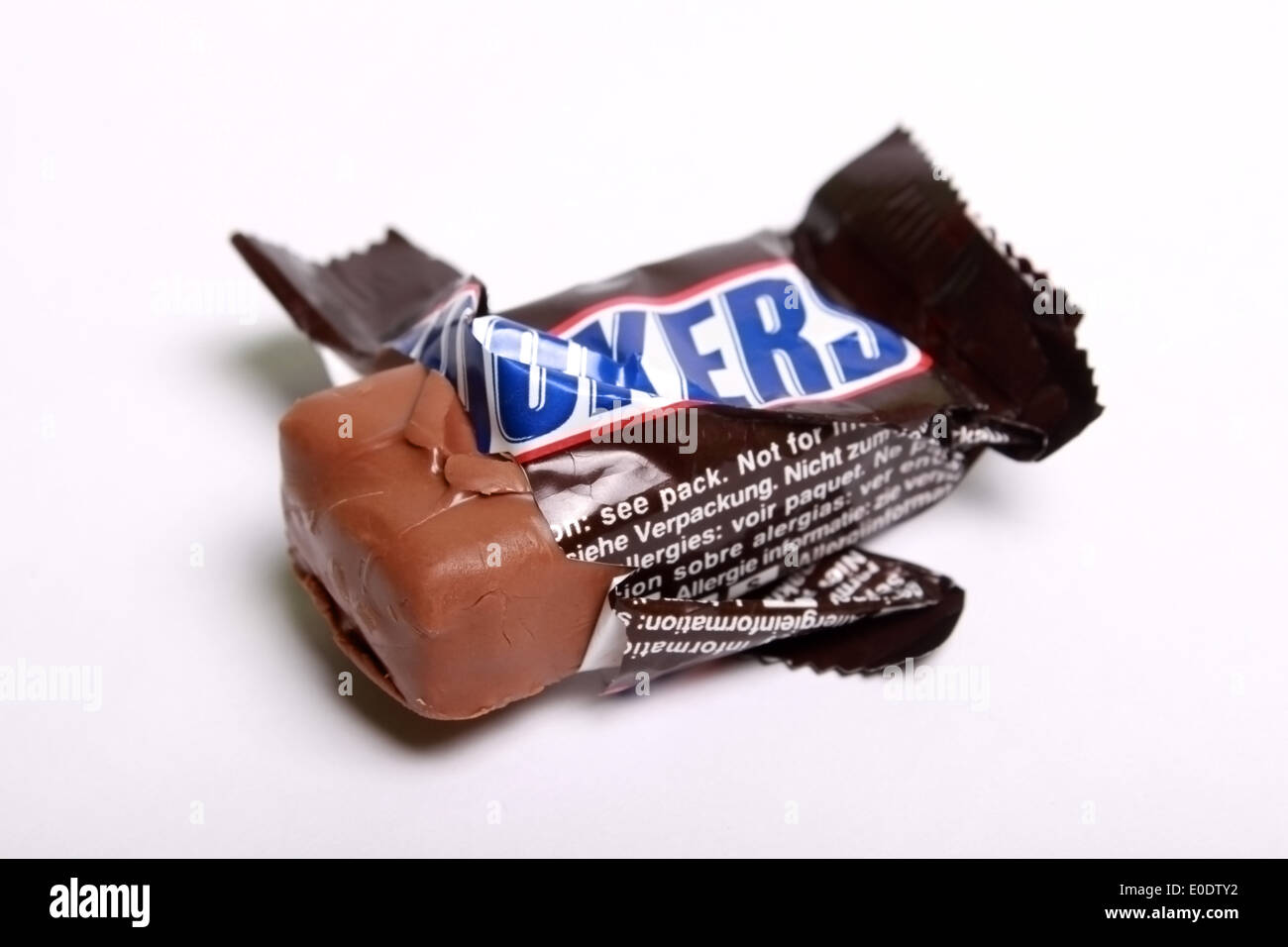 snickers chocolate bar in wrapper - Stock Image