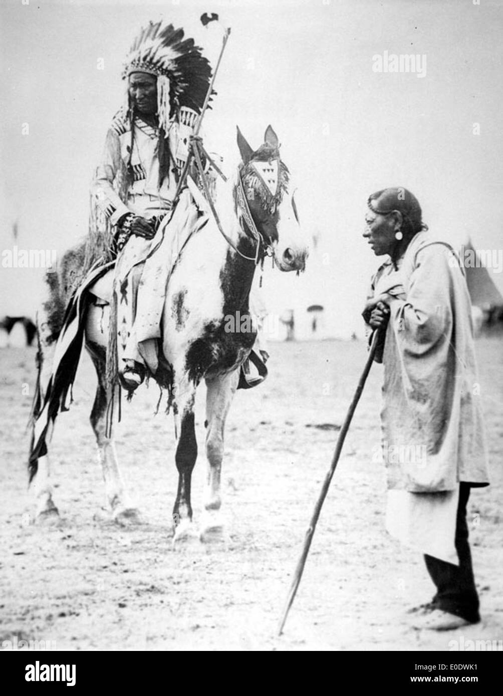 Unidentified Blackfoot Chief On Horseback Speaking To An Elderly Man - Stock Image
