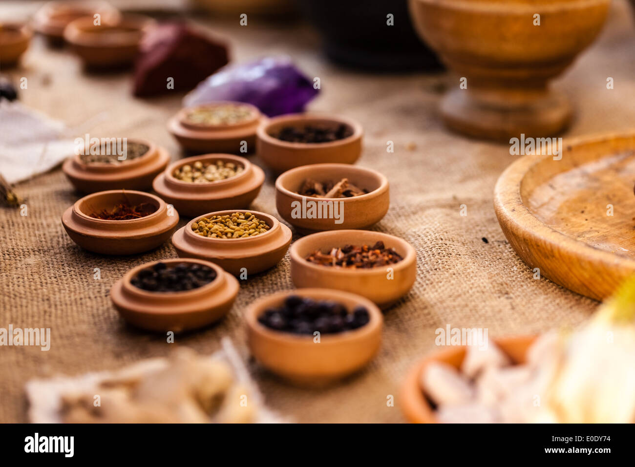 Different Spices In Small Cups Arrangen On A Wooden Table Stock