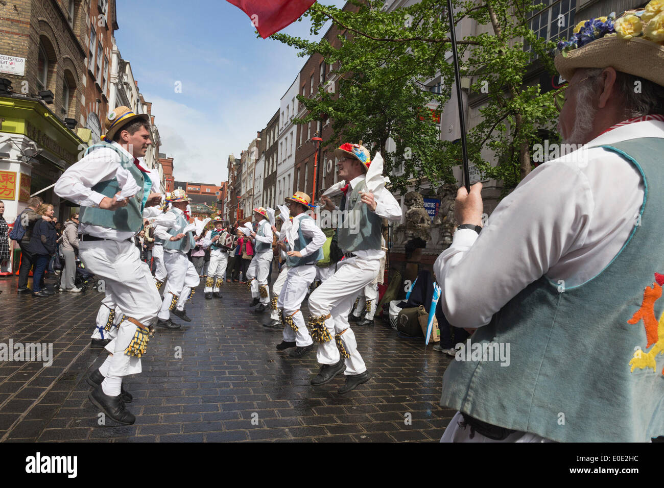 London, UK. 10 May 2014. Pictured: Icknield Way Morris Men from Wantage dancing in Gerrard Street/Chinatown. Morris Dance groups from all over England gathered in London and performed for the public during the Westminster Morris Men Day of Dance. Credit:  Nick Savage/Alamy Live News - Stock Image