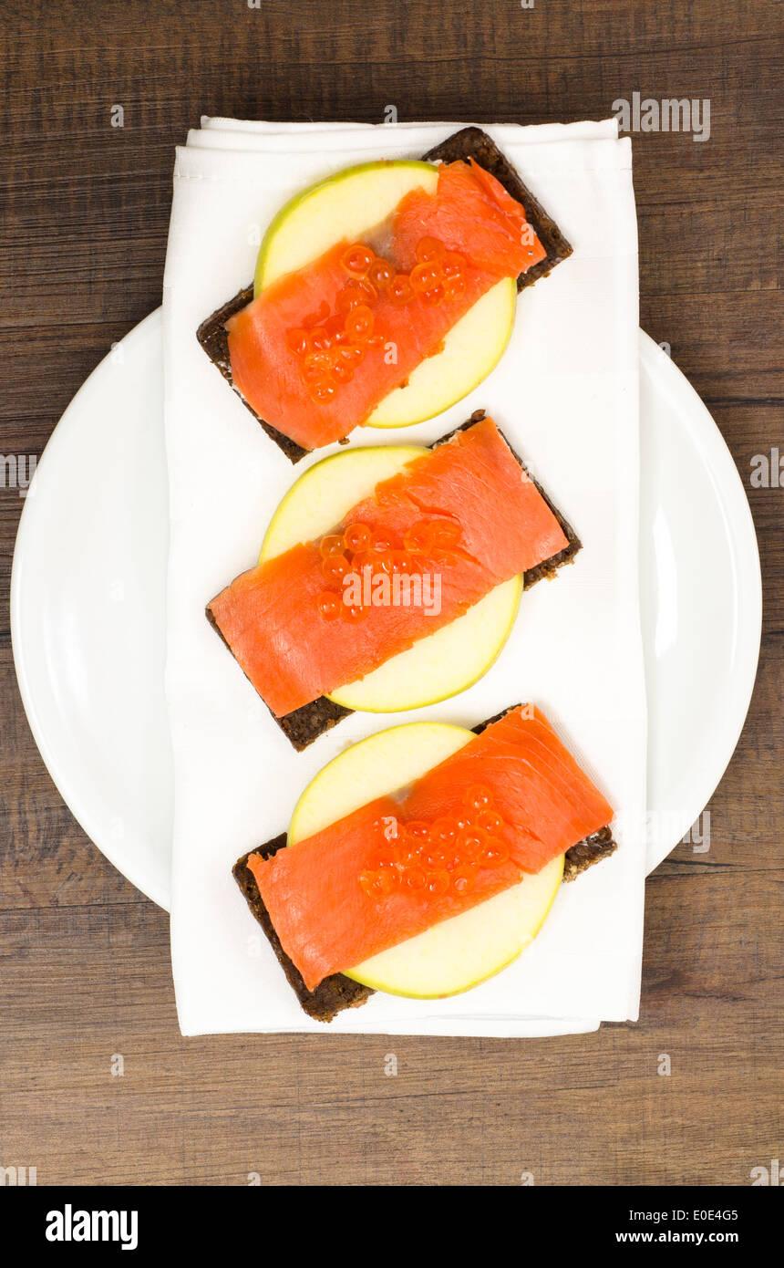 Smoke wild salmon with keta caviar on pumpernickel bread Stock Photo