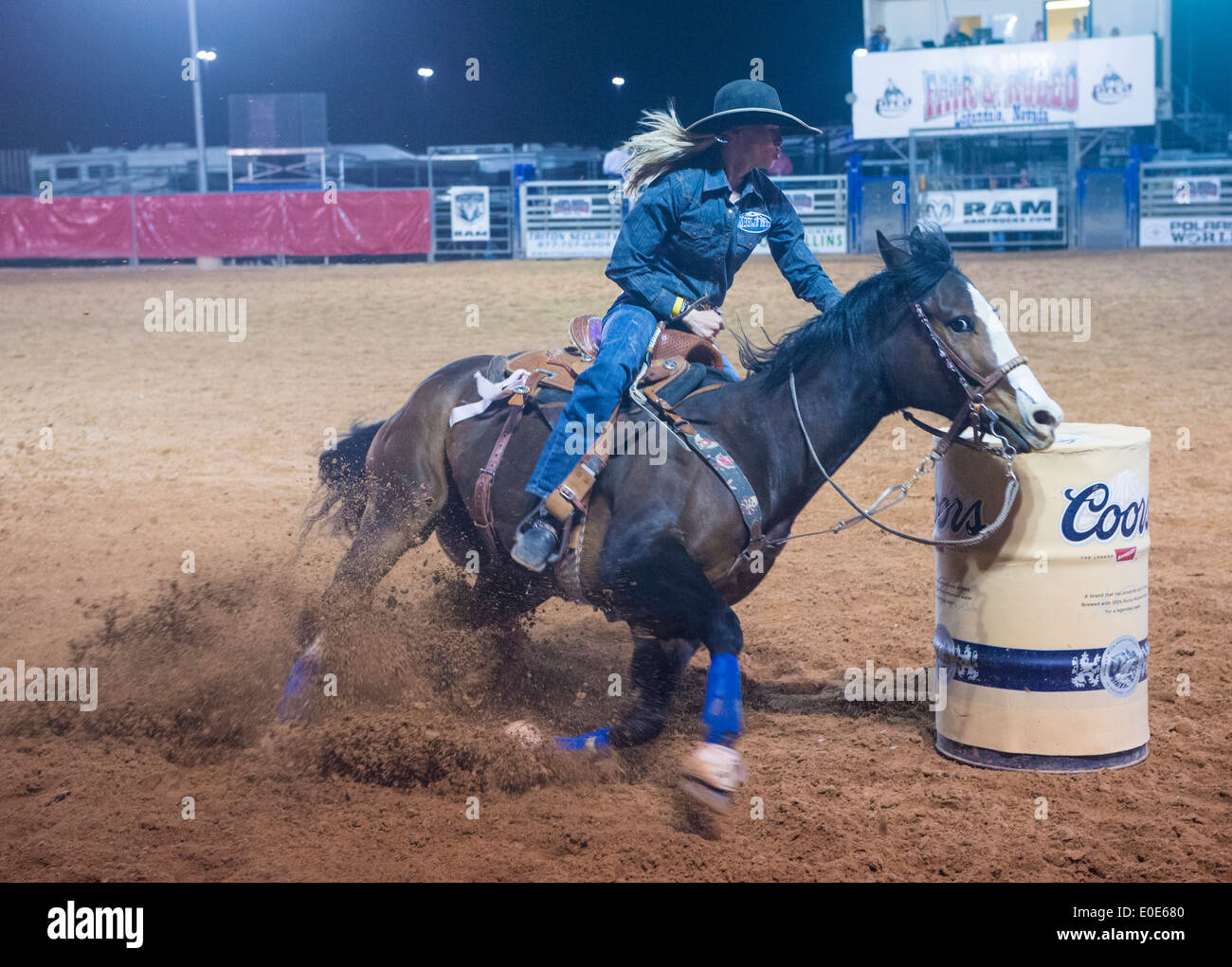 Cowgirl Participating in a Barrel racing competition in the Clark County Rodeo a Professional Rodeo held in Logandale Nevada - Stock Image