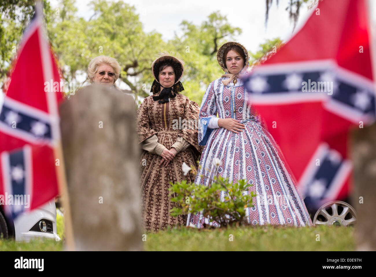 Re-enactors dressed in Civil War era hoop skirts stand at during Confederate Memorial Day events at Magnolia Cemetery April 10, 2014 in Charleston, SC. Confederate Memorial Day honors the approximately 258,000 Confederate soldiers that died in the American Civil War. - Stock Image