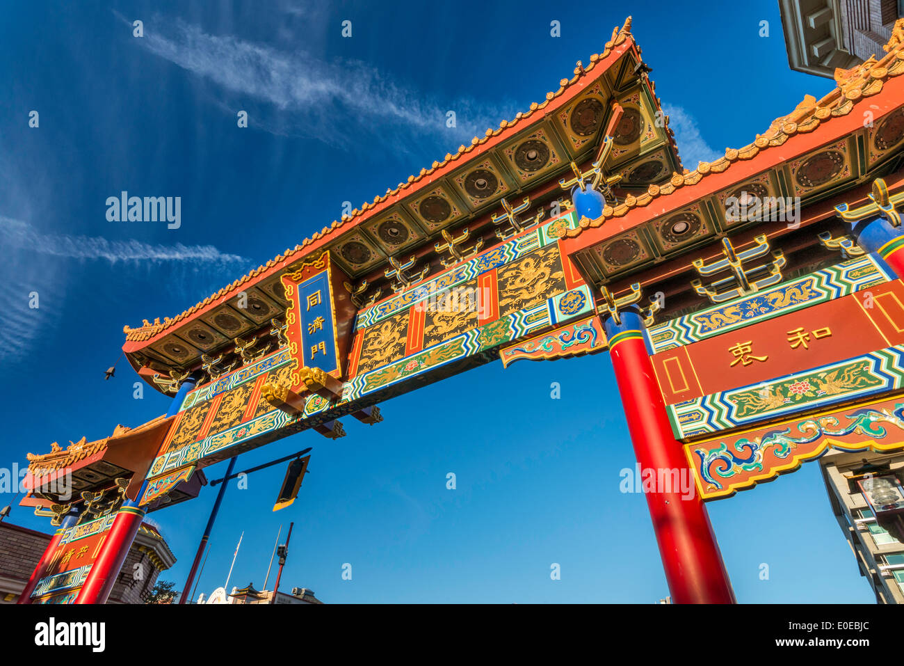 Gate of Harmonious Interest in Chinatown at sunset, Victoria, Vancouver Island, British Columbia, Canada - Stock Image