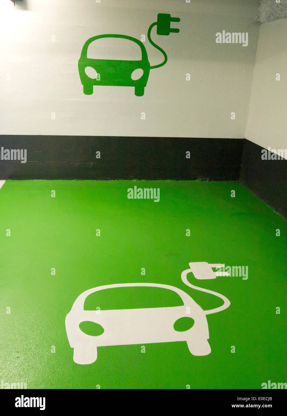 Electric car logos at a charging point - Stock Image