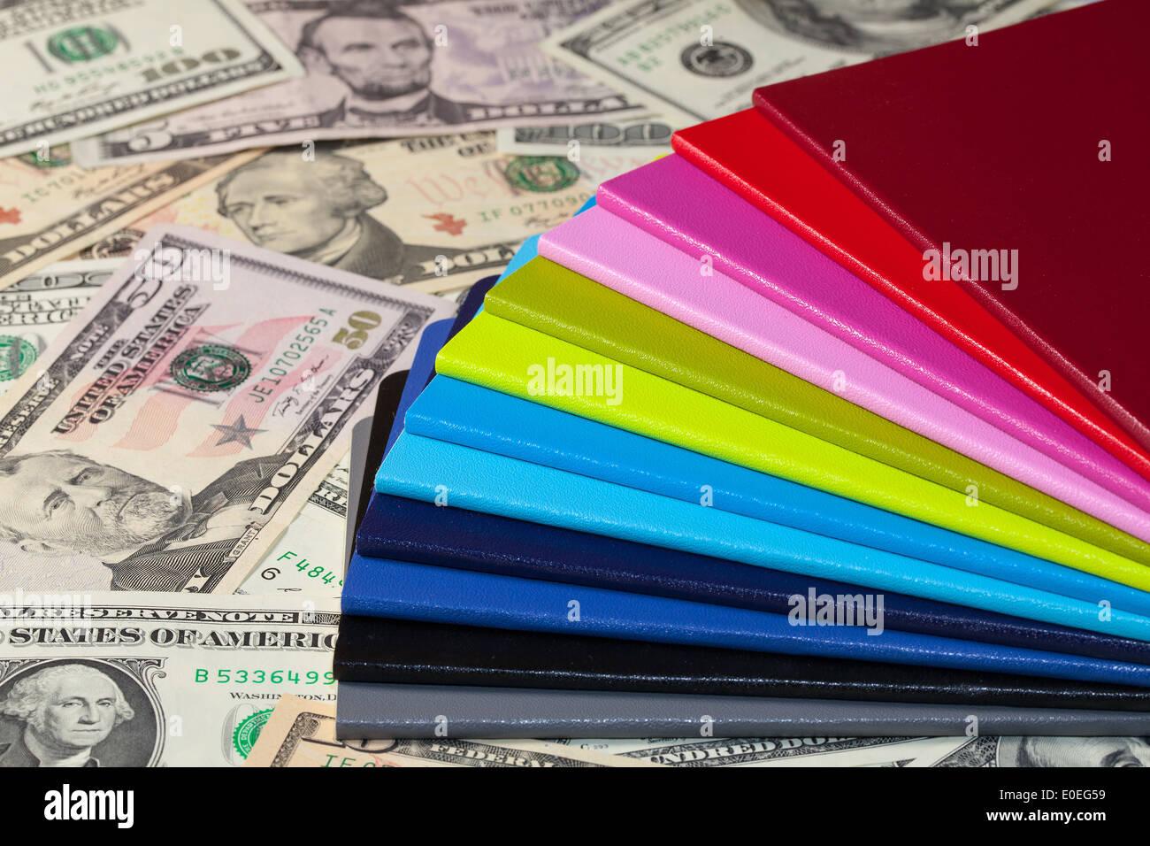 Twelve different diaries and U.S. dollars - Stock Image