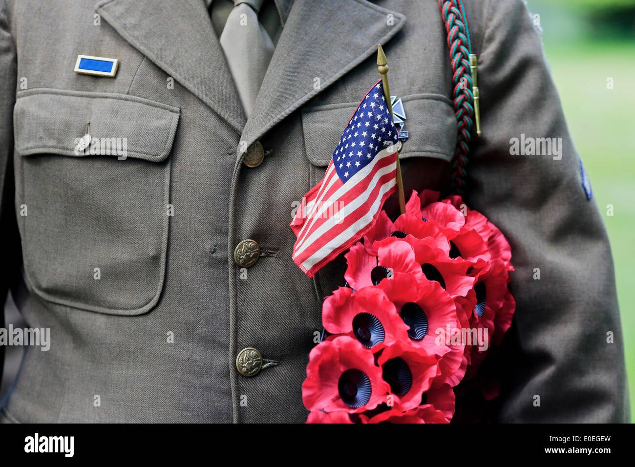 Walditch, Dorset, UK, 11th May 2014. Members of the Living History Association representing men of the 16th Infantry Regiment of the US Army carries a poppy wreath during the Church Parade. Credit:  Tom Corban/Alamy Live News - Stock Image