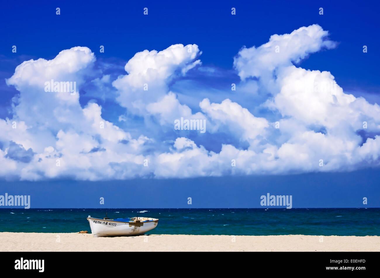 Boat lying on Potistika Beach (Pelion Peninsula, Thessaly, Greece) Stock Photo