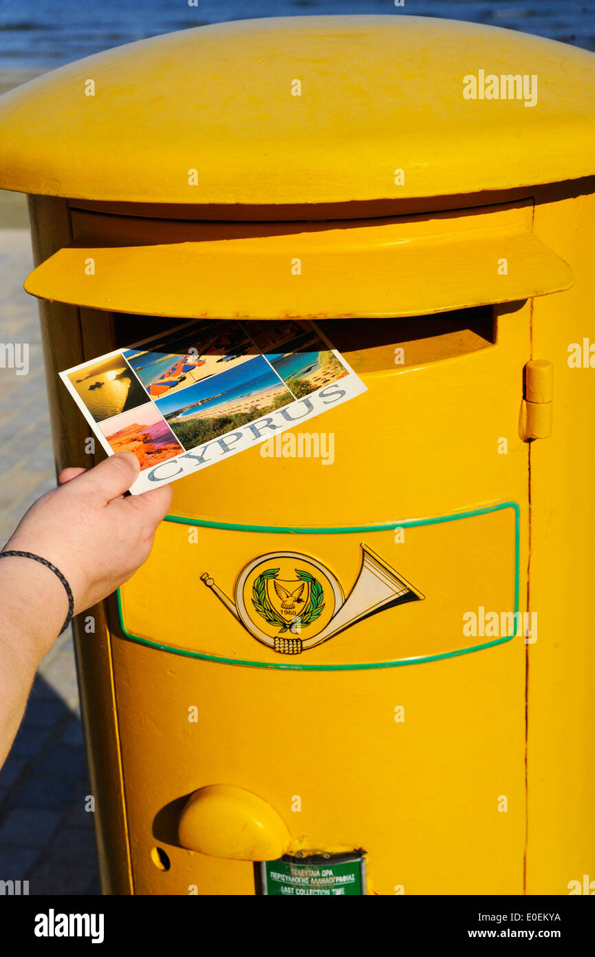 Posting a postcard in Larnaca, Cyprus. - Stock Image