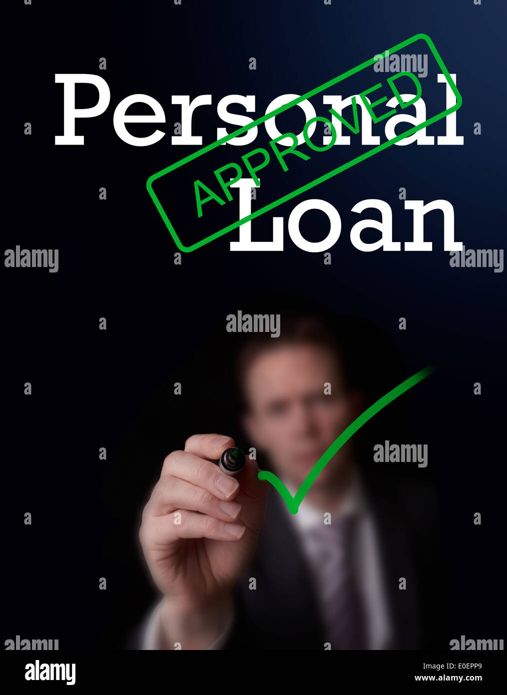 An underwriter writing Personal Loan approved on a screen. - Stock Image