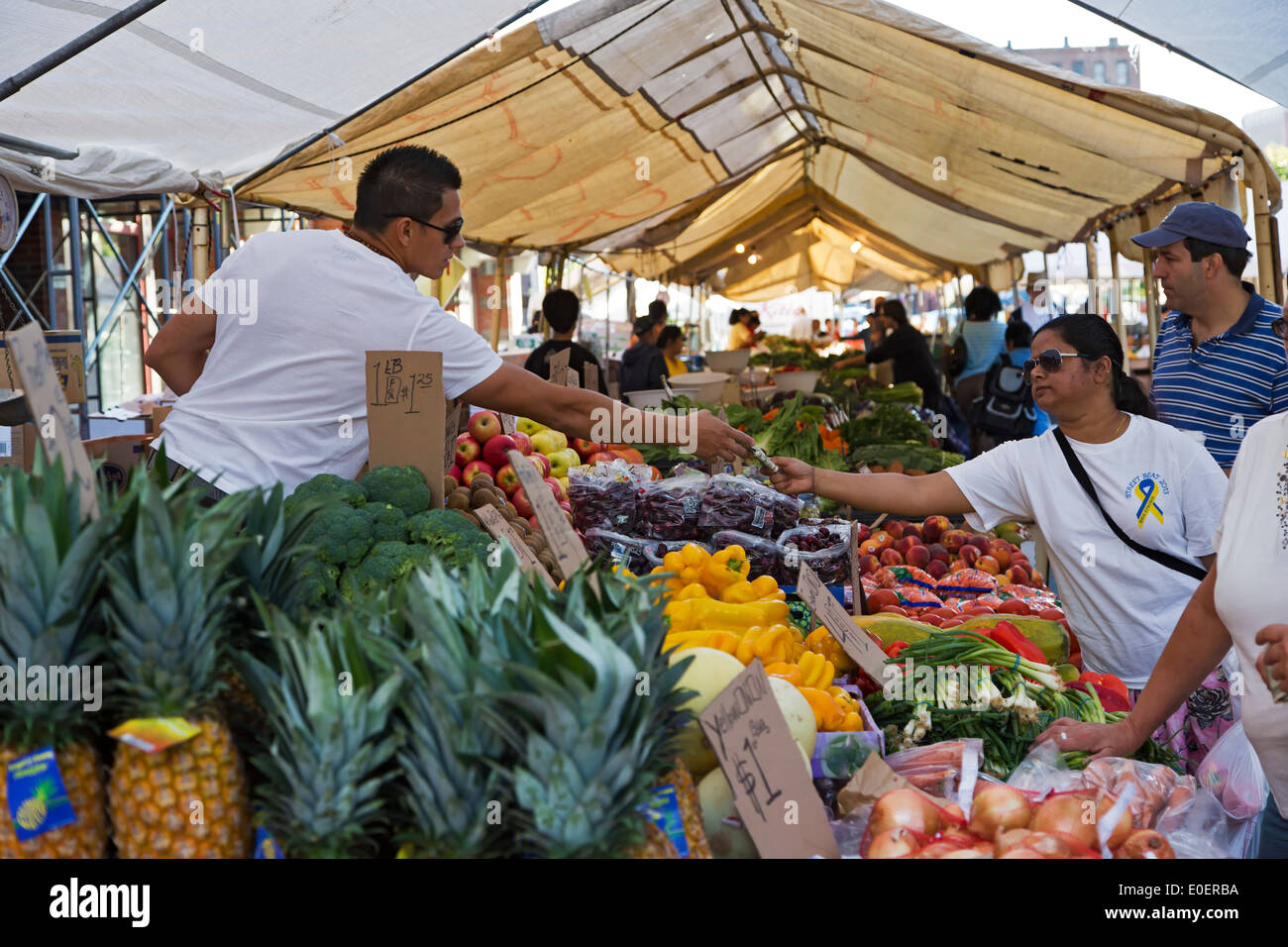 Shoppers and vendors at produce stand, Haymarket Square Farmers Market, North End, Boston, Massachusetts USA - Stock Image
