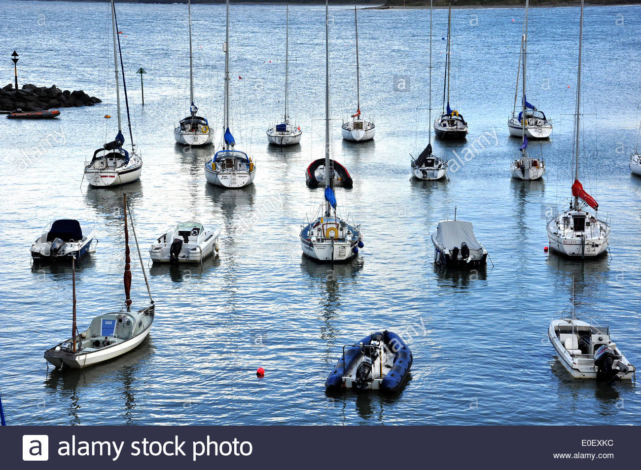 Boats at New Quay Harbour in Ceredigion, Wales, UK - Stock Image