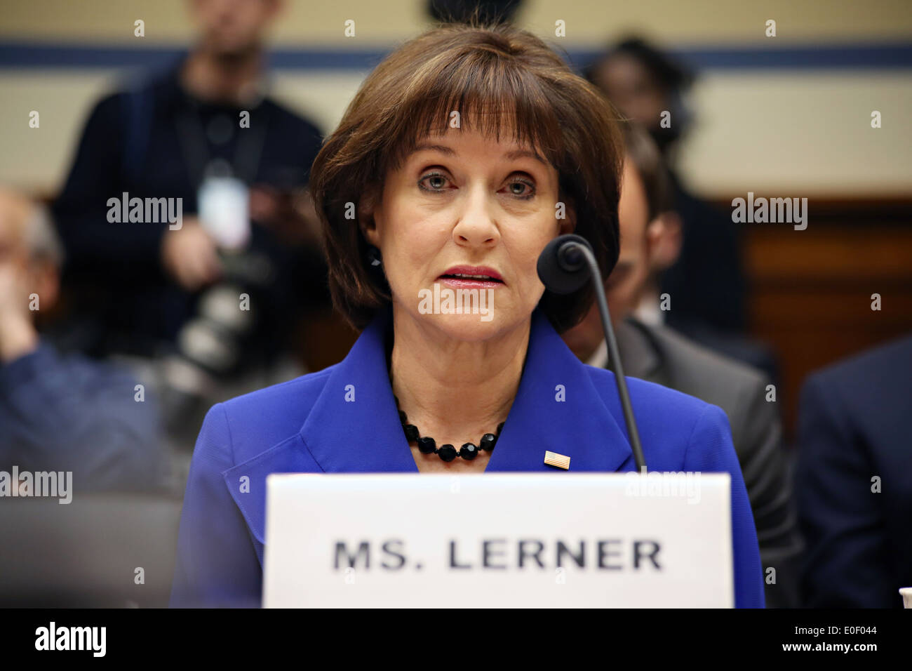 Former Director of the IRS Exempt Organizations division Lois Lerner testifies at the House Oversight and Government Reform Committee hearing on the IRS targeting controversy on Capitol Hill March 5, 2014 in Washington, DC. Lerner invoked her Fifth Amendment right against self-incrimination at the hearing. - Stock Image