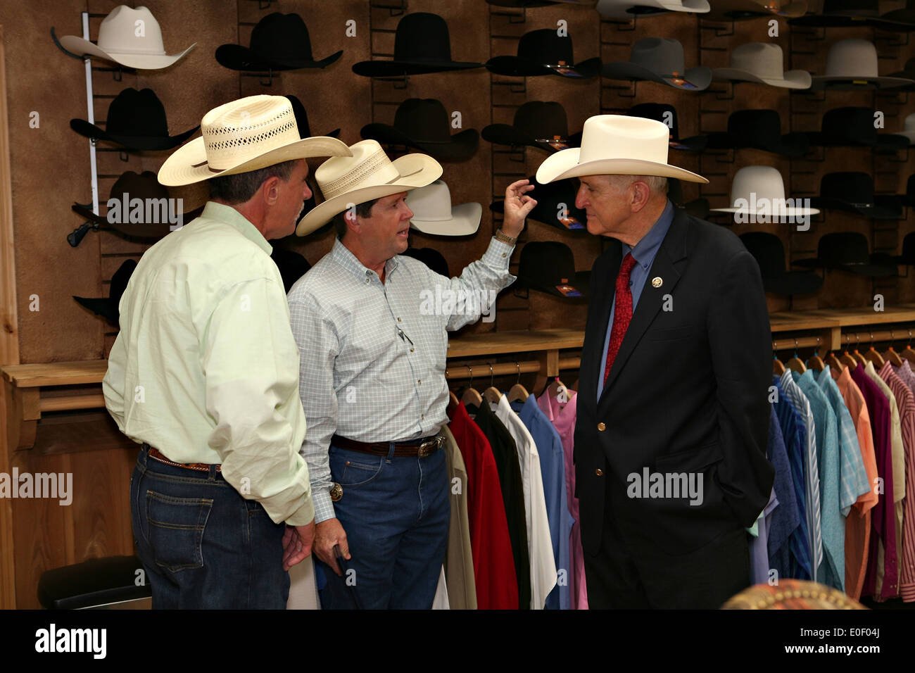US House Rep. Sam Johnson tries on a cowboy hat during a tour of ... c6205d1bc66