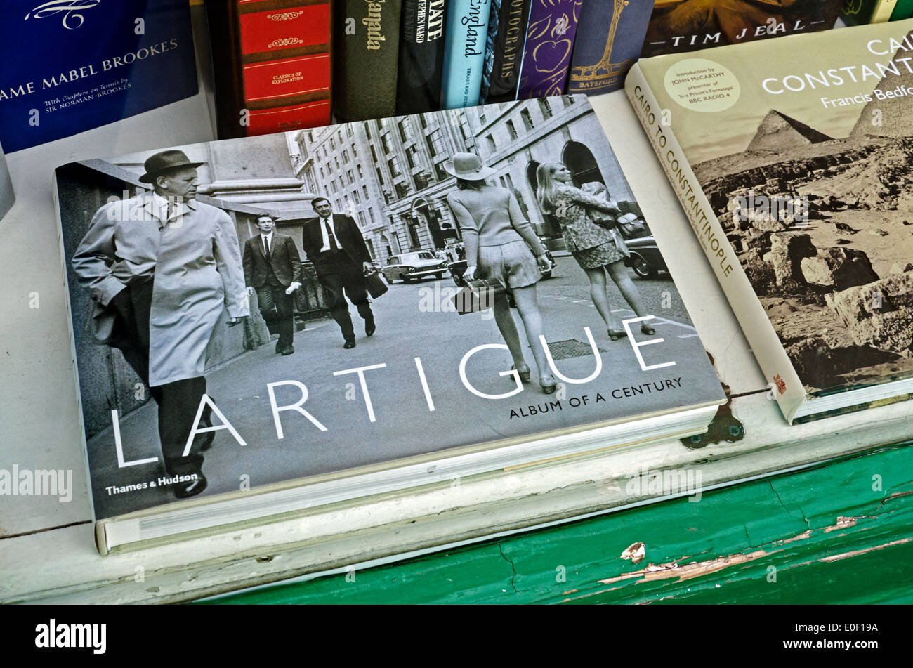 A photography book by the French photographer Jacques Henri Lartigue in the window of a secondhand bookshop in Edinburgh. - Stock Image