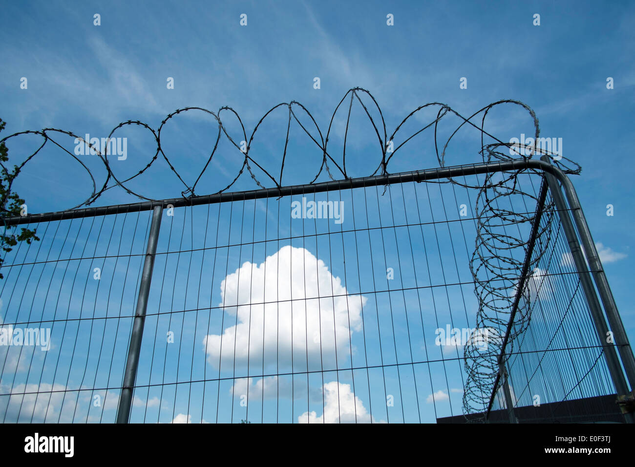 barbed wire fence security safety  Hackney Wick, London, United Kingdom - Stock Image