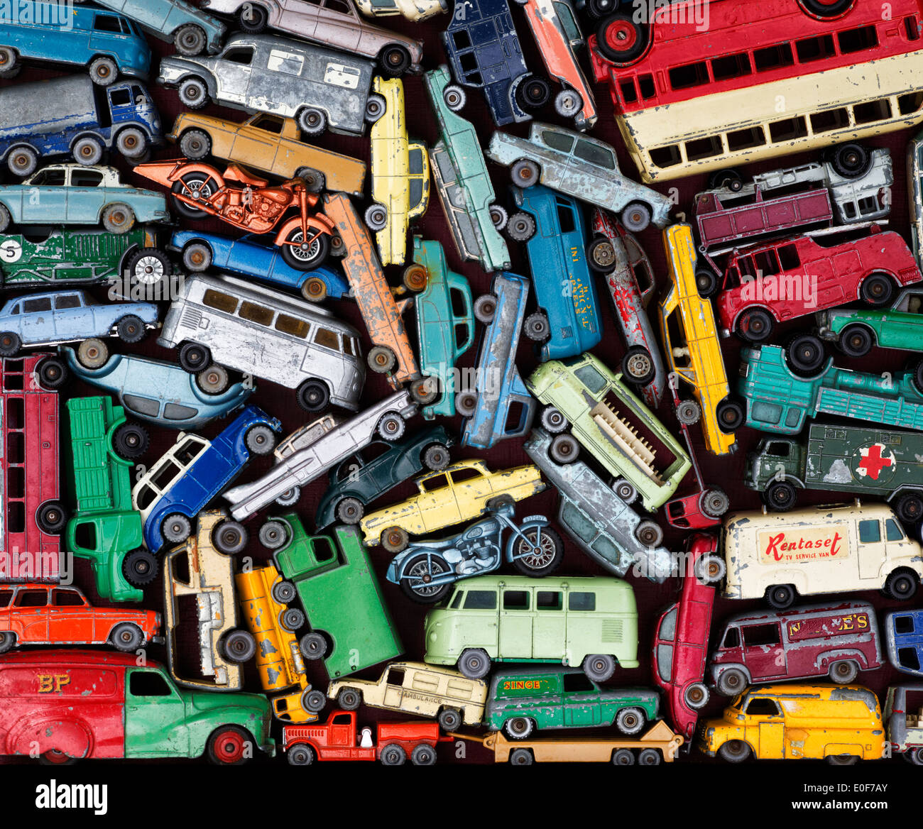 Old playworn Dinky, Matchbox Lesney toy cars, buses, motorbikes pattern - Stock Image