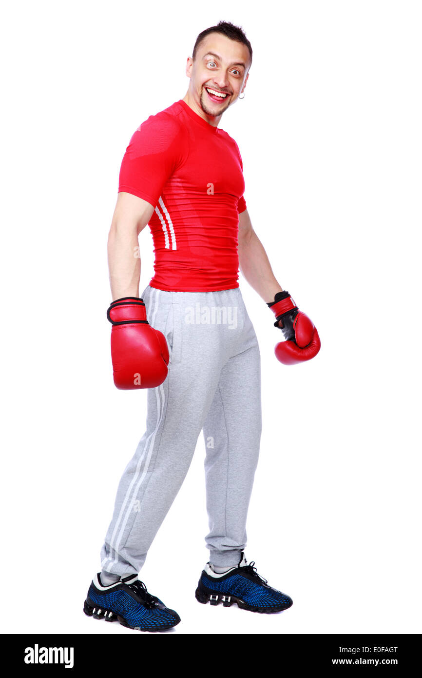 Funny sportsman in boxing gloves standing over white background - Stock Image