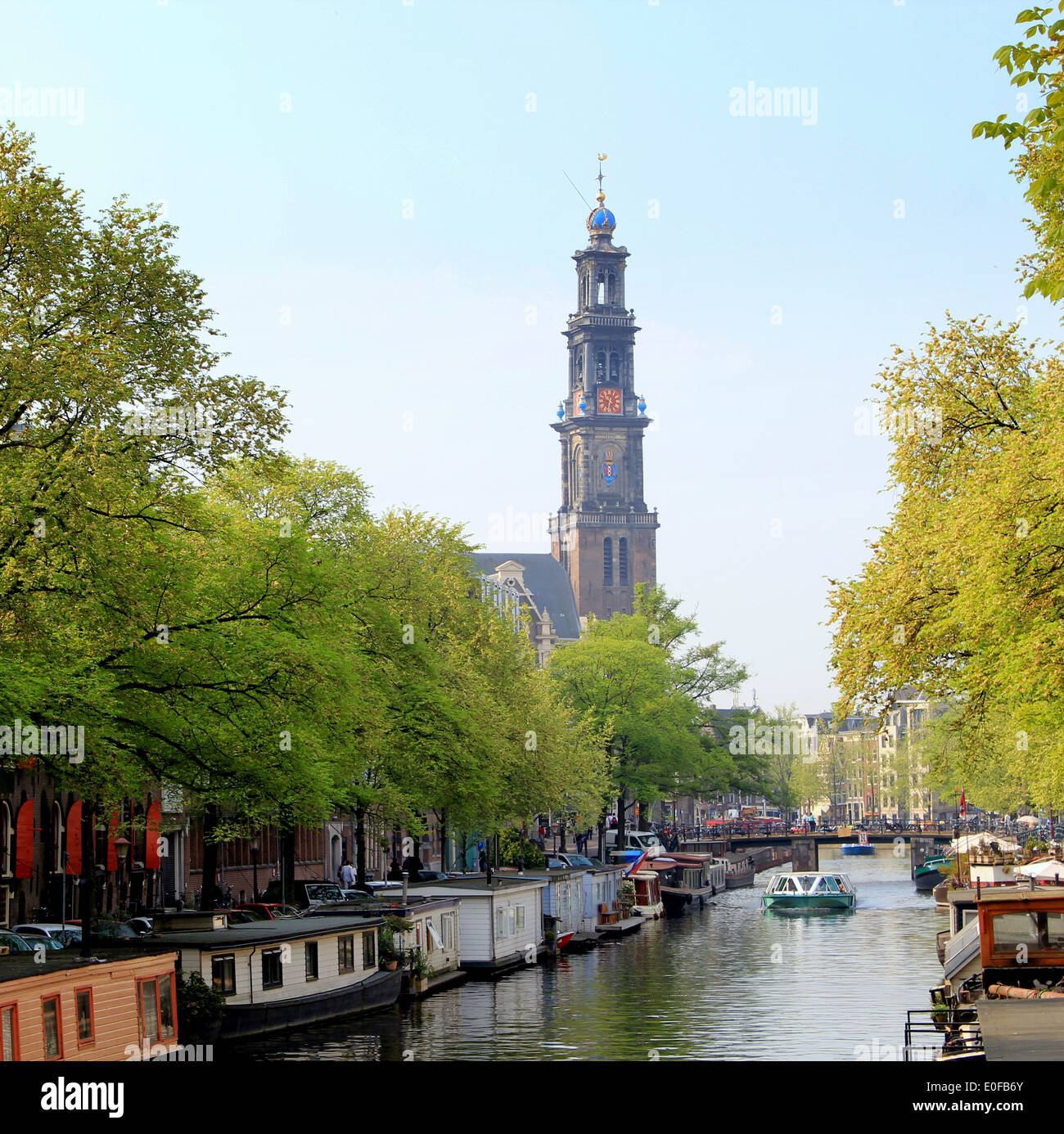 Springtime at Prinsengracht canal with the 17th century Westerkerk in  Amsterdam, the Netherlands in the background - Stock Image