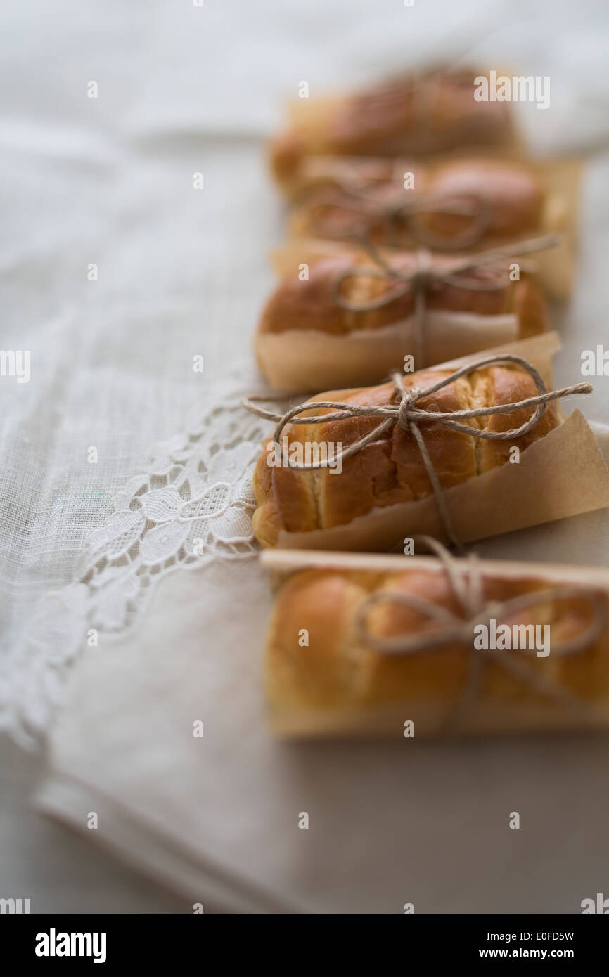 Brioche buns, individually wrapped with string and parchment paper - Stock Image