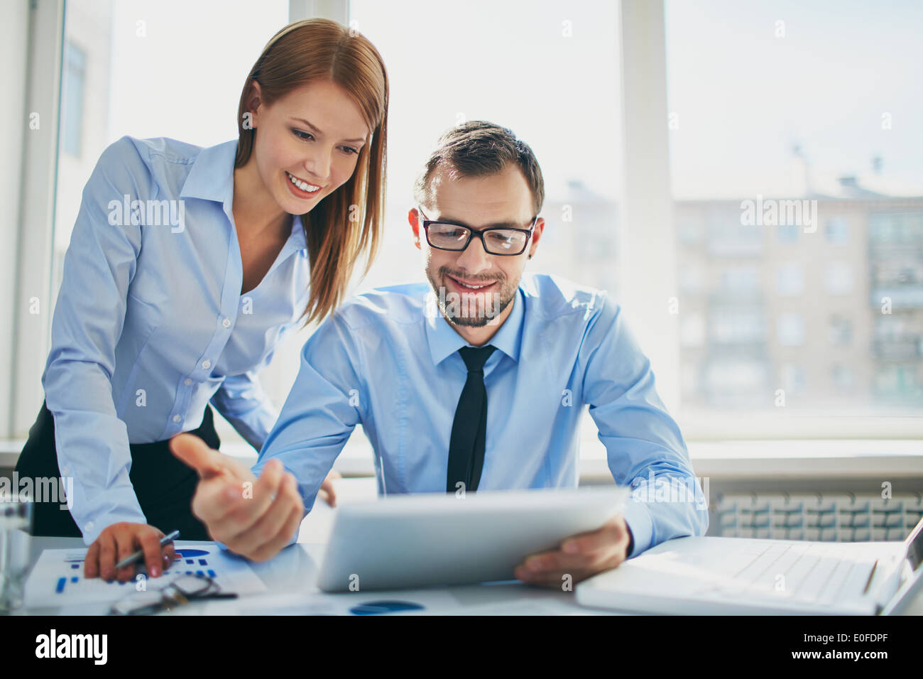 Image of two successful business partners working at meeting in office - Stock Image